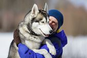 Happy Man With A Husky
