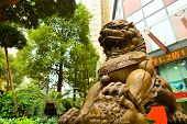 SHENZHEN, CHINA - JAN 06: lion guarding near Bank of China on January 06, 2015. Bank of China Limited is one of the 5 biggest state-owned commercial banks in the People's Republic of China.