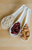 Spoons Of Oats, Cranberries, And Almonds Vertical