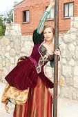 Actress in medieval dress posing