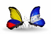 Two Butterflies With Flags On Wings As Symbol Of Relations Columbia And Honduras
