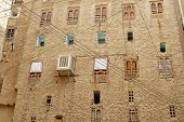 Exterior wall of the mud brick tower house in Shibam, Hadramaut valley, Yemen.