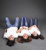 picture of three sisters  - Three sisters lying on the floor in jeans - JPG