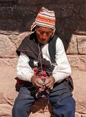 Local Peruvian Man Knitting - Lake Titicaca, Peru