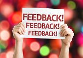 Feedback card with colorful background with defocused lights