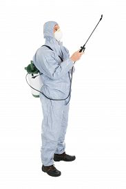 stock photo of pesticide  - Pest Control Worker In Protective Workwear And Mask Spraying Pesticides Over White Background - JPG