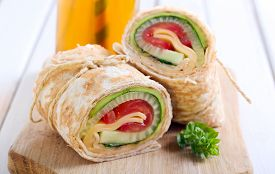 foto of sandwich wrap  - tortilla wrap with vegetable and cheese fillings - JPG