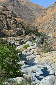 stock photo of drought  - The Kern River flows down through the canyon from the Sierras to the Southern San Joaquin Valley - JPG