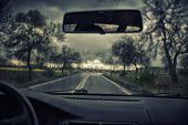 stock photo of rain-drop  - Road view through car window with rain drops