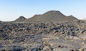pic of unique landscape  - Volcanic Landscape at Craters of the Moon National Monument on a Clear Morning - JPG