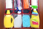 stock photo of detergent  - Different detergents in hanging bag wooden door - JPG