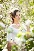picture of japan girl  - Portrait of beautiful girl posing outdoor with flowers of the cherry trees in blossom during a bright spring day - JPG