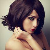 Постер, плакат: Beautiful Makeup Model With Short Black Haircut And Vamp Look