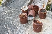 stock photo of fallen  - Seven rusted paint buckets together in a group - JPG