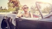 foto of road trip  - Beautiful woman sitting in cabriolet - JPG
