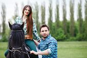 image of horse-breeding  - pair of lovers walk with a horse - JPG