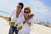 stock photo of gay wedding  - Gay couple drinking a coconut in the Caribbean - JPG