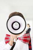 image of suspenders  - Funny man wearing suspenders shouting with megaphone - JPG