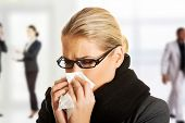 picture of sneezing  - Beautiful woman sneezing because of flu - JPG