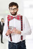stock photo of suspenders  - Funny man wearing suspenders with small shopping basket - JPG