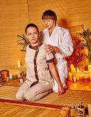 pic of thai massage  - Therapist man giving Thai stretching massage to woman - JPG