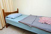 Single Bed In Motel Room