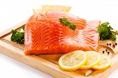 stock photo of salmon steak  - Fresh raw salmon steaks on cutting board  - JPG
