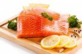 picture of salmon steak  - Fresh raw salmon steaks on cutting board  - JPG