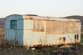 image of shacks  - an old metal shack used by construction workers in a field near Targu-Mures Transylvania Romania ** Note: Soft Focus at 100%, best at smaller sizes - JPG