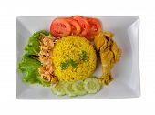 pic of biryani  - Chicken Biryani with fragrant yellow rice on plate - JPG
