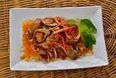 picture of clam  - Stir Fried Surf Clams with Roasted Chili Paste on plate and rattan background - JPG