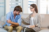 pic of psychologist  - Psychologist comforting a depressed patient in the office - JPG