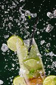 pic of mojito  - Fresh mojito drink with ice cubes and splashes on black background - JPG