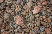 stock photo of raindrops  - The first raindrops hit very dry ground in australia - JPG