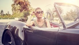stock photo of recreational vehicle  - Beautiful woman sitting in cabriolet - JPG
