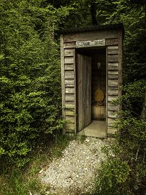 picture of outhouse  - an outhouse pretending to be a telephone booth - JPG