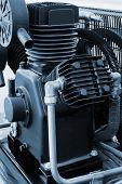 foto of dynamo  - new and powerful motor in a modern workshop - JPG