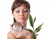 Young Woman With Green Plant And Globe.