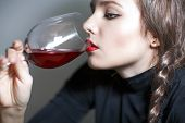Young Beautiful Girl Testing  Red Wine