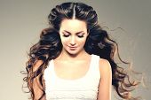 Постер, плакат: Model with long hair Waves Curls Hairstyle Hair Salon Updo Fashion model with shiny hair Woman