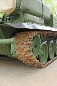 Постер, плакат: Part Of The Undercarriage Of Tracked Military Equipment Close up