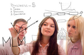 stock photo of marketing plan  - The business team are writing a marketing plan on white background - JPG