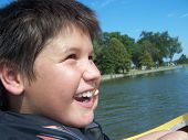 Happy Boy In A Paddle Boat