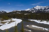 Shallow Crystal Blue Mountain River In Banff