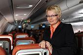 Pretty woman posing in the board of plane