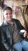 Portrait Of Twentysomething Man With Dark Stout Beer