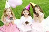 picture of birthday party  - Three young girls outdoors merry celebrate a birthday give gifts - JPG