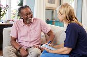 Female Support Worker Visits Senior Man At Home poster
