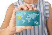 Woman holding credit card, closeup poster