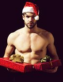 Santa Muscular Man With Present Boxes poster